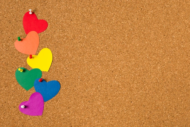 Gay pride concept on cork background