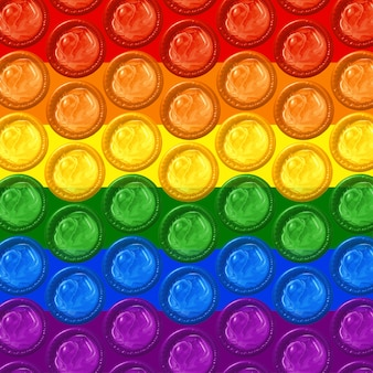 Gay pride flag background of rainbow colored condoms. concept of lesbian, gay bisexual and transgender pride.