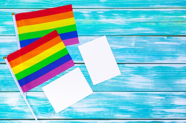 Gay pride flag on wooden table background