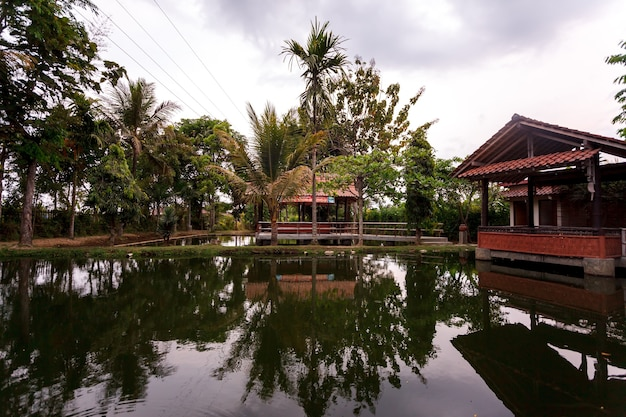 Gazebo in the middle of a lake on java, indonesia