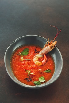 Gazpacho soup with shrimps (red soup) portion. food background. copy space