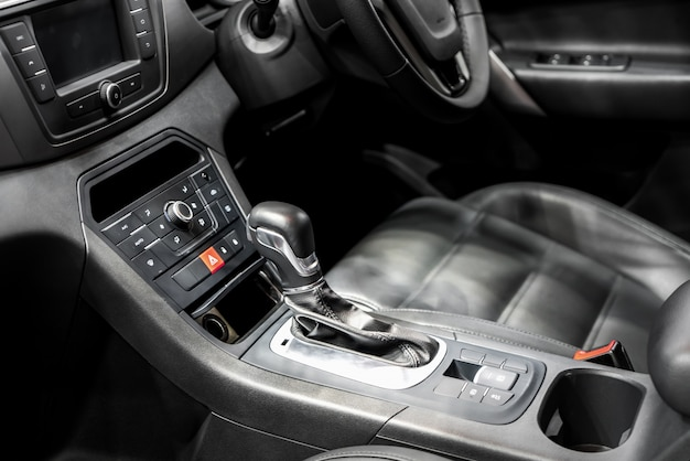 Gear lever or shift lever with cup holder and air condition control in modern car.