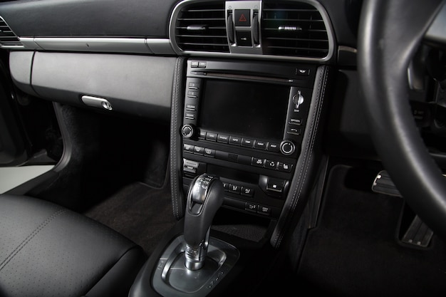 Gear shift and control buttons of a black car