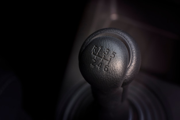 Gear stick of manual transmission car with 6 position.