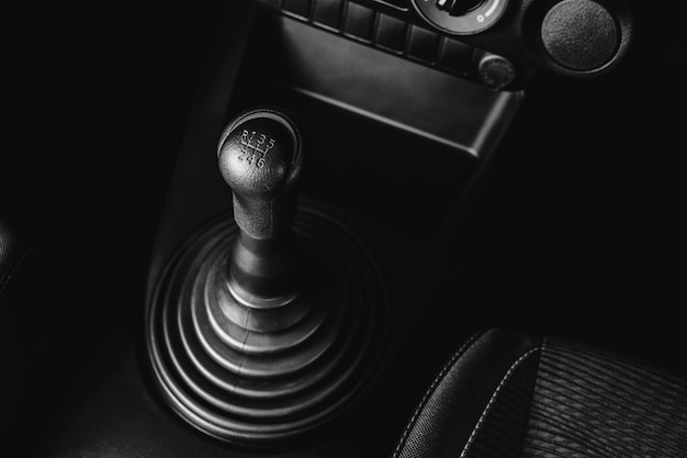 Gear stick of manual transmission of car with 6-speed and reverse position, automotive part concept.