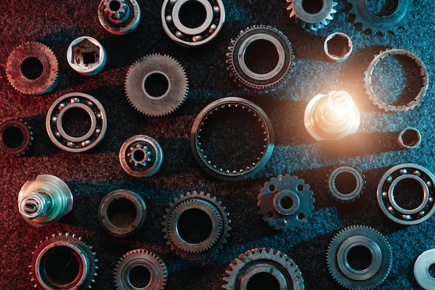 Gears and bearings on a dark background