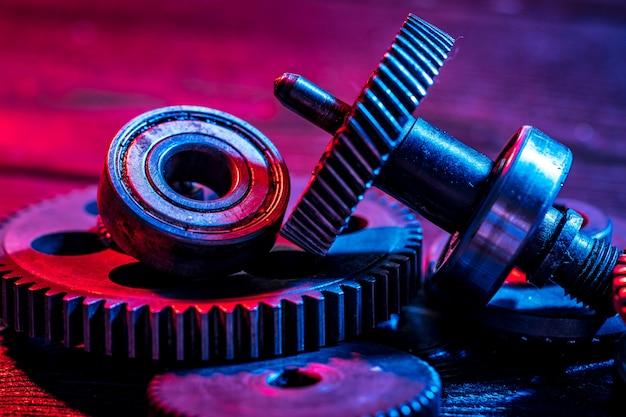 Gears. machine part. neon color.