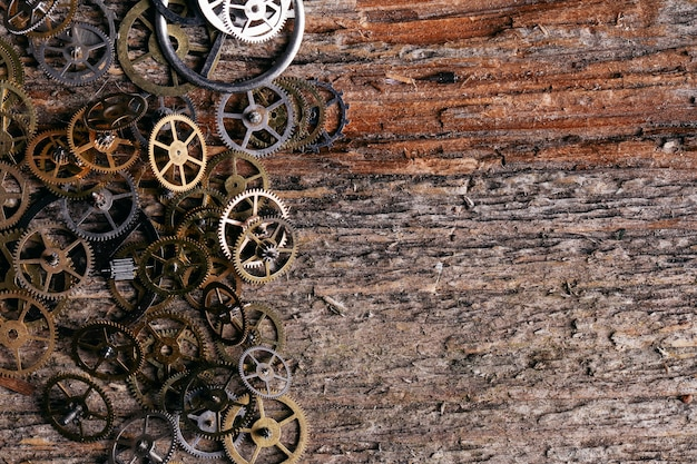 Gears on wooden table background