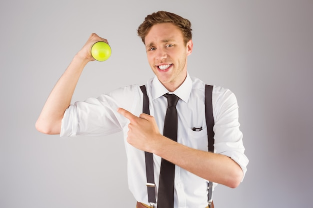 Geeky businessman lifting a dumbbell