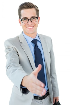Geeky businessman offering his hand