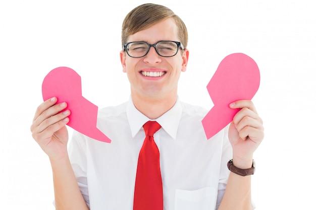 Geeky hipster holding a broken heart card