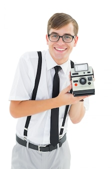Geeky hipster holding a retro camera