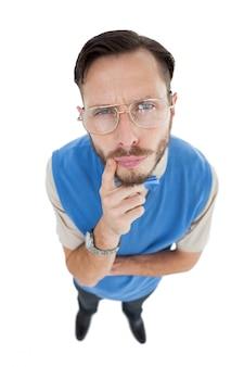 Geeky hipster looking at camera