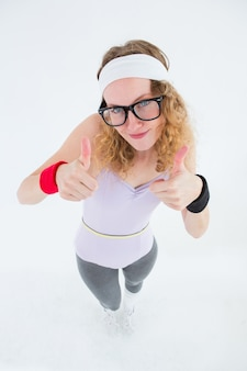 Geeky hipster posing with thumbs up