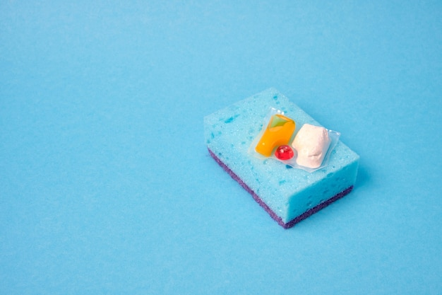 Gel capsules for dishwashers and sponges the choice between washing dishes with your hands or in the dishwasher