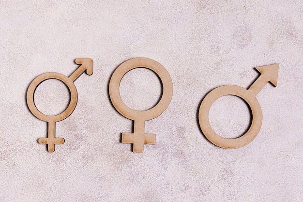 Gender signs on marble background