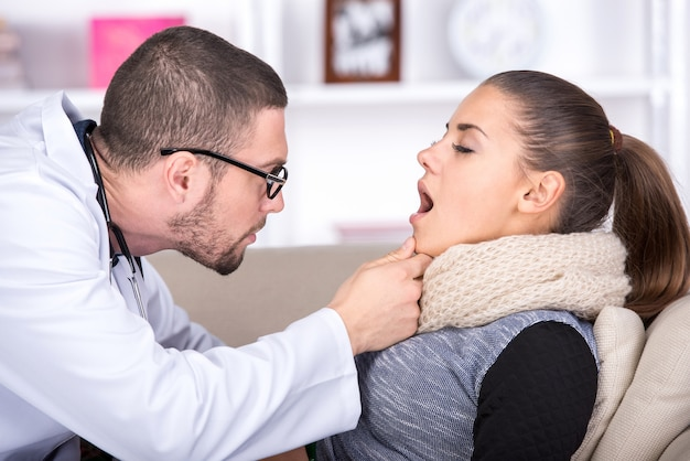 General practitioner examining mouth and throat.