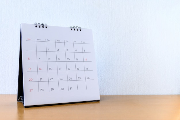Generic calendar with days on wood table