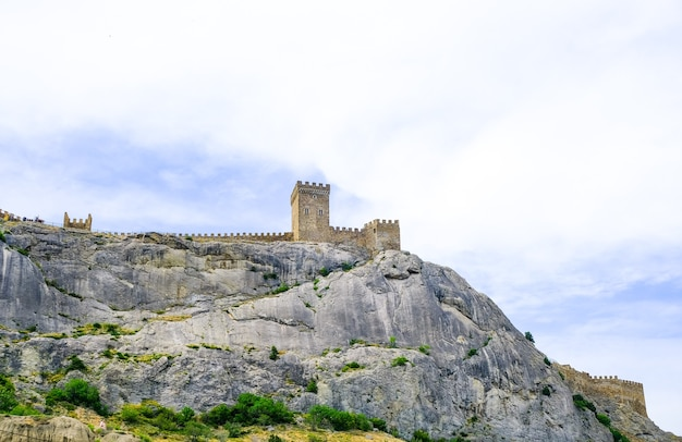 Genoese fortress in the sudak bay on the peninsula of crimea view from the sea