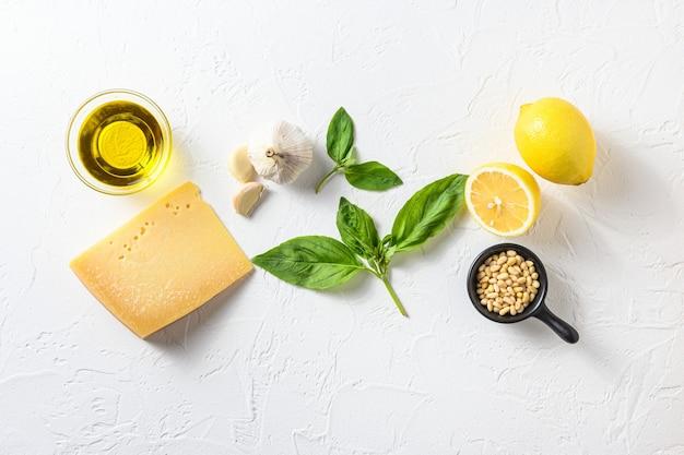 Genovese pesto ingredients concept or ingredients parmesan cheese, basil leaves
