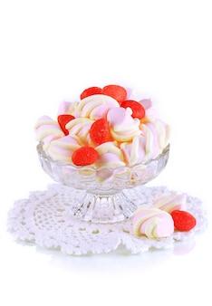 白のガラスの花瓶に優しいマシュマロ