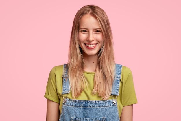 Gentle smiling fenale has long straight hair