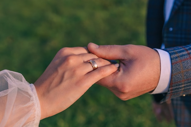 The gentle touch of the hands of the newlyweds in love beautiful and romantic holding