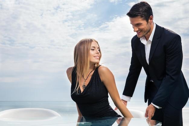 Gentleman helping his womanfriend at restaurant