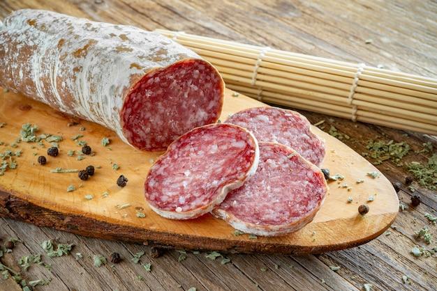 Genuine homemade neapolitan salami with pork, spices and salt