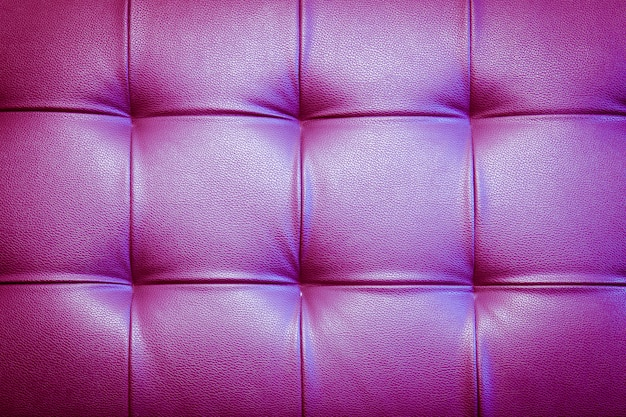 Genuine leather upholstery background for a luxury decoration in purple tones