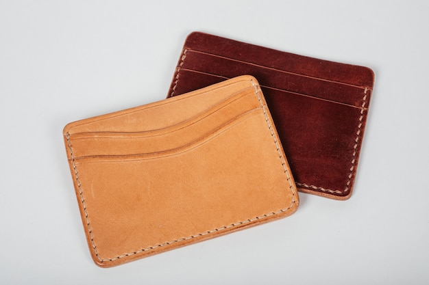 Genuine leather wallet brown color on isolated white background.