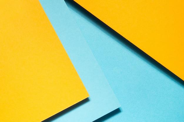 Геометрическая композиция из синего и желтого картона