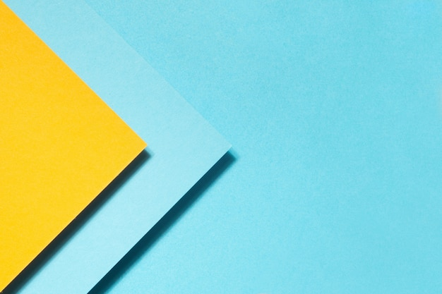 Geometric composition made with blue and yellow cardboard