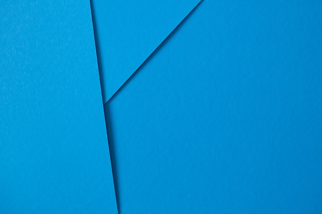 Geometric composition with blue paperboard with copyspace