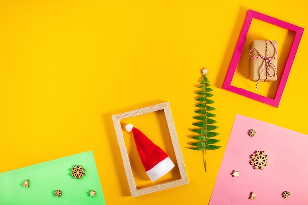 Geometric creative christmas flat lay on colorful pastel trendy background
