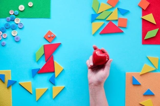Геометрический дизайн для всемирного дня аутизма с треугольниками-головоломками tangram