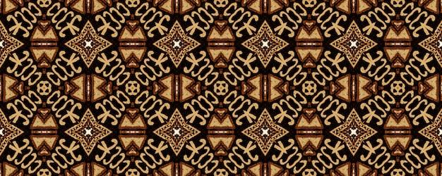 幾何学的な刺繍。ブラウンヒップスターヴィンテージシームレスパターン。