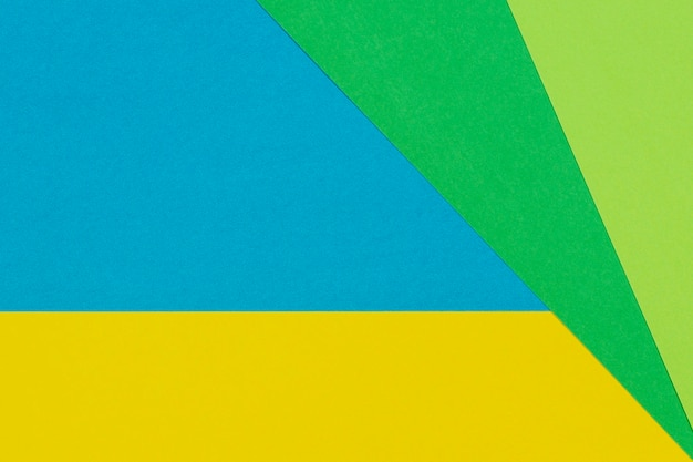 Geometric flat lay yellow green blue color paper wall