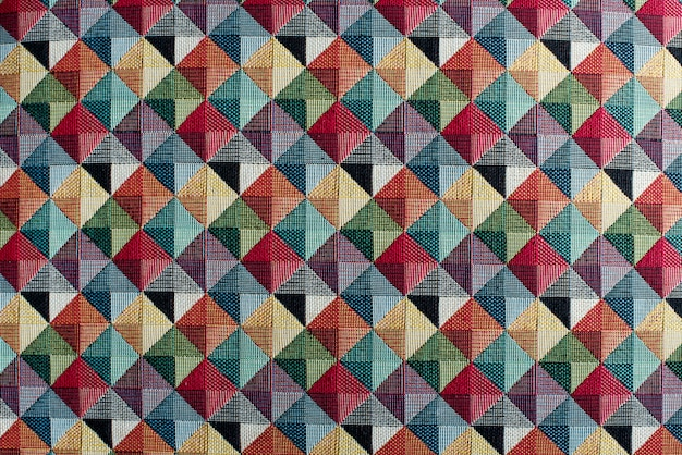 Geometric multicolored textile background pattern