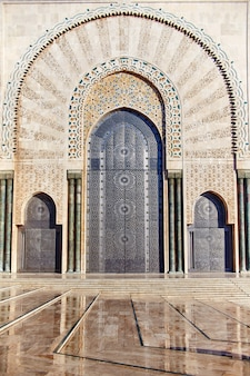 Geometric muslim mosaic in islamic mosque, beautiful arabic tile pattern and mosaic on the wall and doors of mosque in casablanca city, morocco