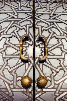 Geometric muslim mosaic in islamic mosque, beautiful arabic tile pattern and mosaic on wall and doors of mosque in casablanca city, morocco