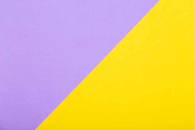 Geometric paper background of yellow and purple colors. flat lay mockup