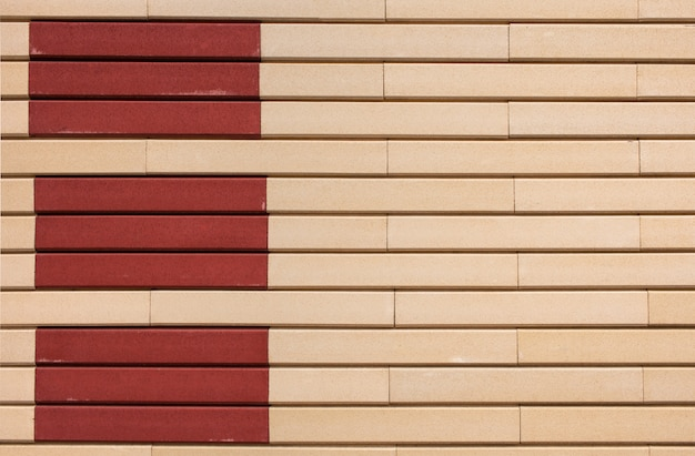Geometric pattern of beige and terracotta rectangles on the wall