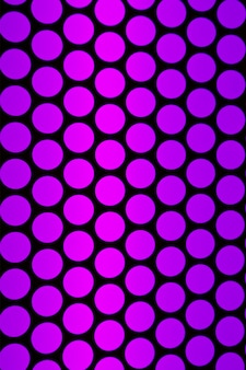 Geometric pattern of the elevator ceiling in purple pink and black color