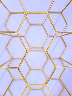 Geometric pattern of hexagons made of metal in gold color on a purple . concept , abstraction