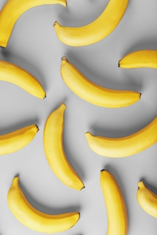Geometric pattern of yellow bananas on a gray background in the fashionable colors of 2021
