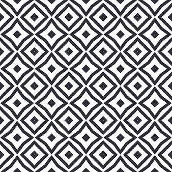幾何学的なシームレスパターン。黒の対称的な万華鏡の背景。テキスタイルレディの素晴らしいプリント、水着生地、壁紙、ラッピング。手描きの幾何学的なシームレスなデザイン。