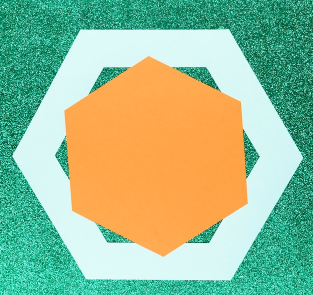 Geometric shapes on green background