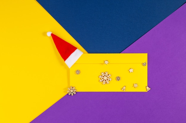 Geometric xmas background on trendy colored paper. above view of multicolored geometric layered paper background in yellow, blue, purple. christmas, new year, winter concept