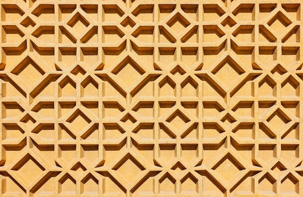 幾何学的な抽象的なアラビアのパターン-建築の細部のクローズアップ、背景として使用できます